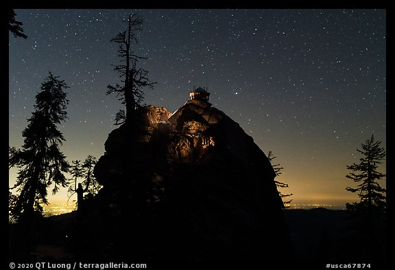 Buck Rock and Central Valley lights at night. Giant Sequoia National Monument, Sequoia National Forest, California, USA (color)
