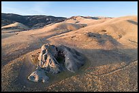 Aerial view of U-shaped rock outcrop named Painted Rock. Carrizo Plain National Monument, California, USA ( )