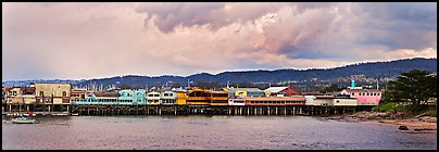Fishermans Wharf colorful buildings at sunset. Monterey, California, USA (Panoramic color)