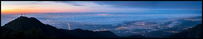Foggy Los Angeles Basin from Mount Wilson at sunrise. Los Angeles, California, USA (Panoramic color)