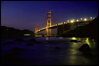 Golden Gate bridge and surf seen from E Baker Beach, night. San Francisco, California, USA ( color)