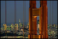 The city seen through the cables and pilars of the Golden Gate bridge, night. San Francisco, California, USA
