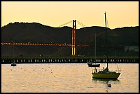 Sailboat in the Marina, with Golden Gate Bridge at sunset in the background. San Francisco, California, USA ( color)