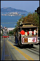 Cable car on Hyde Street, with Alcatraz Island in the background. San Francisco, California, USA (color)