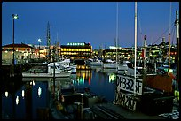 Fishing boat in  Fisherman's Wharf, with Alioto's in the background, dusk. San Francisco, California, USA (color)