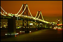 Bay Bridge seen from Treasure Island with defocused lights, sunset. San Francisco, California, USA ( color)