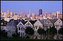 Victorians at Alamo Square and skyline, dusk. San Francisco, California, USA ( color)