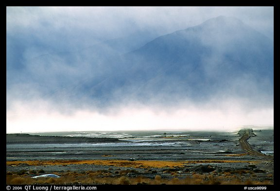 Mineral deposits of dry lake stirred up by a windstorm, Owens Valley. California, USA
