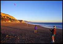 Flying a kite at Santa Maria Beach, late afternoon. Point Reyes National Seashore, California, USA