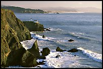 Cliffs and Point Bonita Lighthouse, late afternoon. California, USA