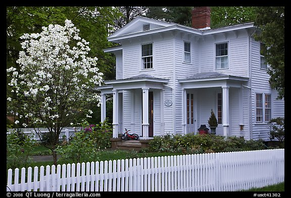 White picket fence and house, Essex. Connecticut, USA