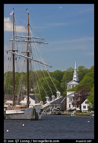 Tall ship and white steepled church. Mystic, Connecticut, USA