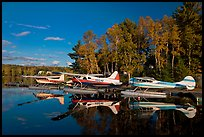 Floatplanes and reflections in Moosehead Lake  late afternoon, Greenville. Maine, USA