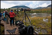Cameras set up with telephoto lenses, Sandy Stream Pond. Baxter State Park, Maine, USA (color)
