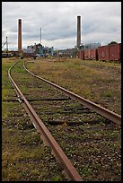 Railroad tracks and smokestacks, Millinocket. Maine, USA (color)