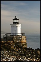 Bug Light with boy running. Portland, Maine, USA