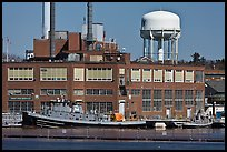 Tugboats and brick buildings, Naval Shipyard. Portsmouth, New Hampshire, USA (color)