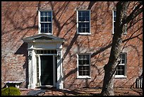 Brick house with tree shadows. Portsmouth, New Hampshire, USA