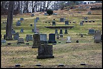 Headstones of different sizes in cemetery. Walpole, New Hampshire, USA