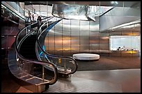 Curved moving staircase and meeeting room, Bloomberg building. NYC, New York, USA ( color)