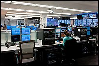 Bloomberg News analyst working in front of many screens. NYC, New York, USA ( color)
