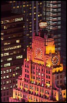 Top of vintage high-rise building with globe and clocks. NYC, New York, USA ( color)