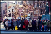 Gathering in Chinatown in winter. NYC, New York, USA