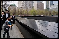 Jewish family walks by 9/11 Memorial. NYC, New York, USA ( color)