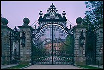 Entrance gate of the Breakers mansion at dusk. Newport, Rhode Island, USA
