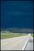 Storm cloud over road. South Dakota, USA