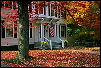 House with American flag and red leaves. Vermont, New England, USA (color)
