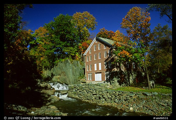 Old Mill next to a cascading brook near Stowe. Vermont, New England, USA