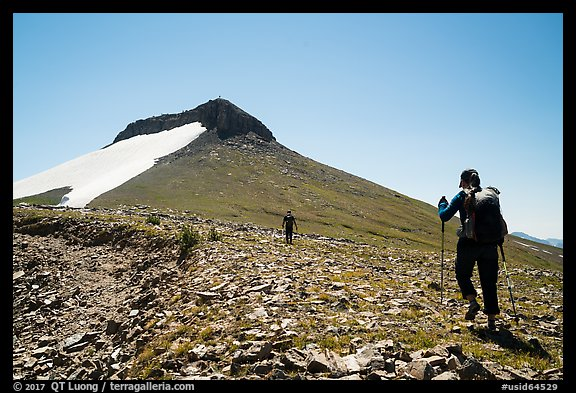 Hikers approaching Table Mountain off trail. Jedediah Smith Wilderness,  Caribou-Targhee National Forest, Idaho, USA (color)