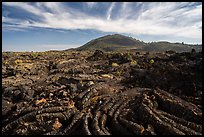 Pahoehoe lava and Big Cinder Butte. Craters of the Moon National Monument and Preserve, Idaho, USA ( )
