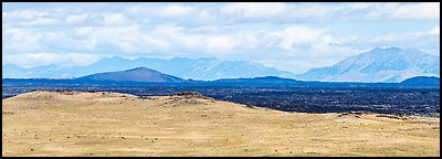 Craters of the Moon Lava Flow and Pioneer Mountains. Craters of the Moon National Monument and Preserve, Idaho, USA (Panoramic color)
