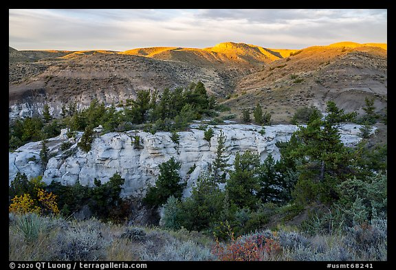 Sandstone pinnacles and hill with last light. Upper Missouri River Breaks National Monument, Montana, USA (color)
