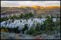 Sandstone pinnacles and hill with last light. Upper Missouri River Breaks National Monument, Montana, USA ( color)