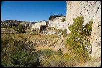 Sandstone cliffs surround native campsite. Upper Missouri River Breaks National Monument, Montana, USA ( )