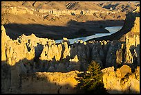 Sandstone pinnacles and river. Upper Missouri River Breaks National Monument, Montana, USA ( color)