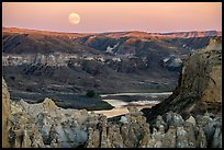 Moonrise over pinnacles and river. Upper Missouri River Breaks National Monument, Montana, USA ( color)