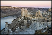 Sandstone pinnacles and moon. Upper Missouri River Breaks National Monument, Montana, USA ( color)
