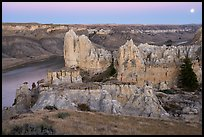Sandstone spires and moon at twilight. Upper Missouri River Breaks National Monument, Montana, USA ( color)