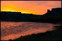 Distant Hole-in-the-Wall at sunrise. Upper Missouri River Breaks National Monument, Montana, USA ( color)