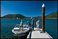 Family boarding boat, East Lake. Newberry Volcanic National Monument, Oregon, USA ( color)