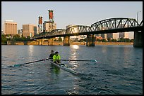 Men on double-oar shell rowing on Williamette River. Portland, Oregon, USA
