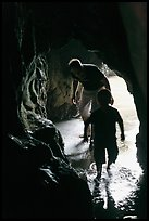 Boy and man exploring sea cave. Bandon, Oregon, USA ( color)