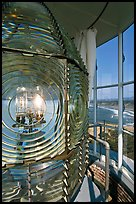 Rotating light inside Cape Blanco Lighthouse tower and landscape. Oregon, USA