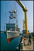 Fishing boat hoisted from water, Port Orford. Oregon, USA (color)
