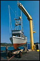 Fishing boat lifted from water by huge hoist, Port Orford. Oregon, USA ( color)