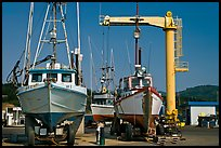 Fishing boats parked on deck with hoist behind, Port Orford. Oregon, USA ( color)